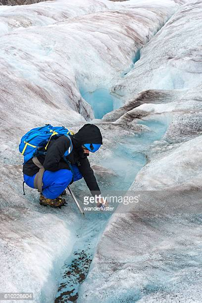 Refilling bottle with icy glacial water