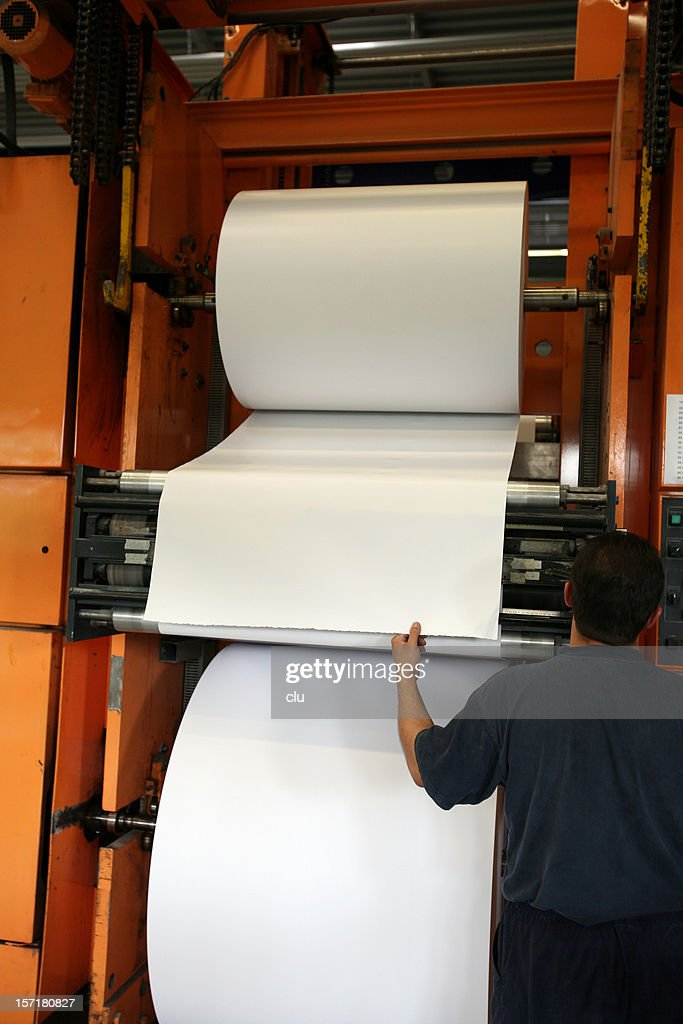 Refilling huge paper roll : Stock Photo