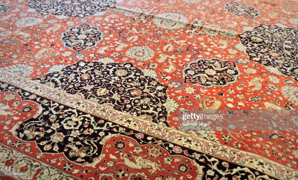 Refined design patterns of old Iranian rug in Tabriz : Stock Photo