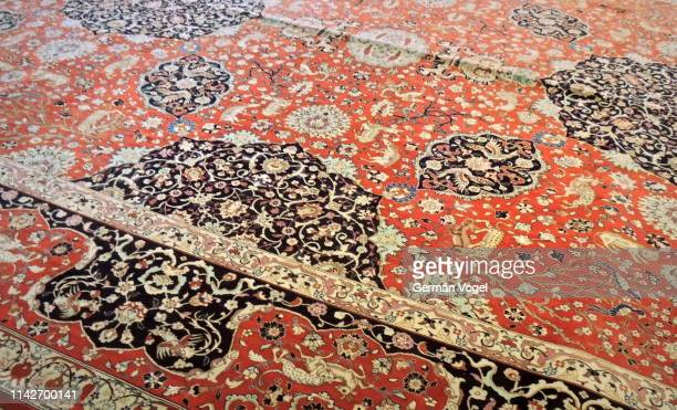 refined design patterns of old iranian rug in tabriz - persian rug stock photos and pictures