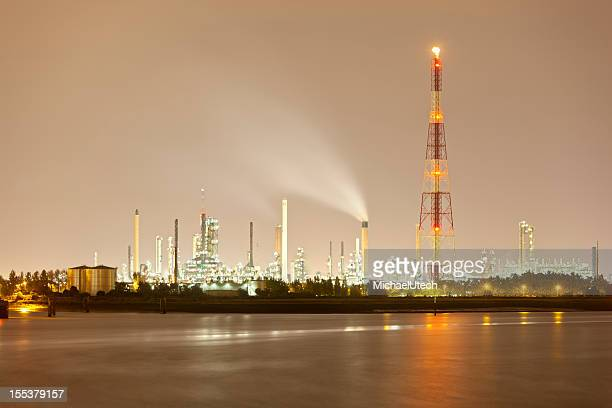refinery and flare stack at night - flare stack stock photos and pictures