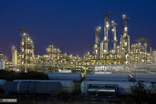 Refinery And Railroad Cars At Night