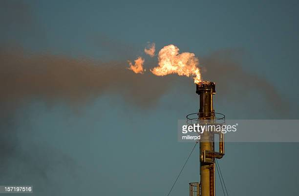 refinery flare - flare stack stock photos and pictures