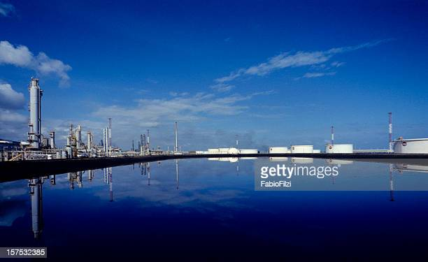 refinery reflected in the blue - fabio filzi stock photos and pictures