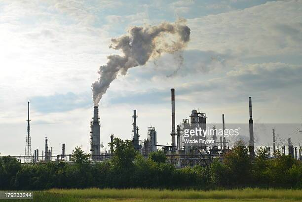Refinery silhouette with active smokestack. This was taken on a sunny Summer day in Toledo, Ohio.