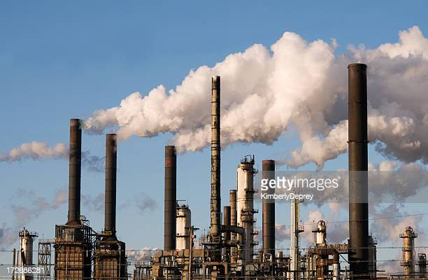 refinery with smoke stacks