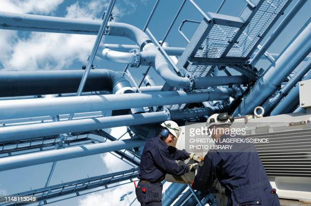 refinery workers - pipeline stock pictures, royalty-free photos & images