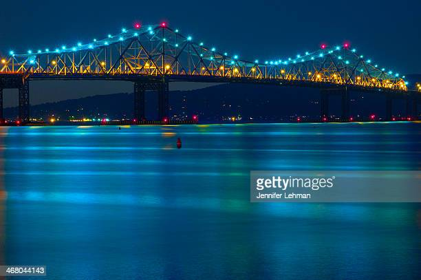 CONTENT] Reflected colors from the lighted peaks of the Tappan Zee Bridge at Tarrytown NY The horizontal stripes in the water are from waves created...