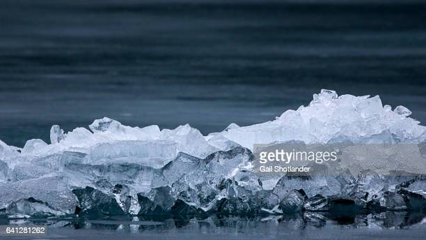 Reflected Ice Clumps by Lake