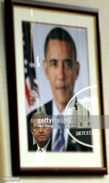 Reflected in an image of US President Barack Obama US Agriculture Secretary Tom Vilsack speaks during a news conference at the Agriculture Department...