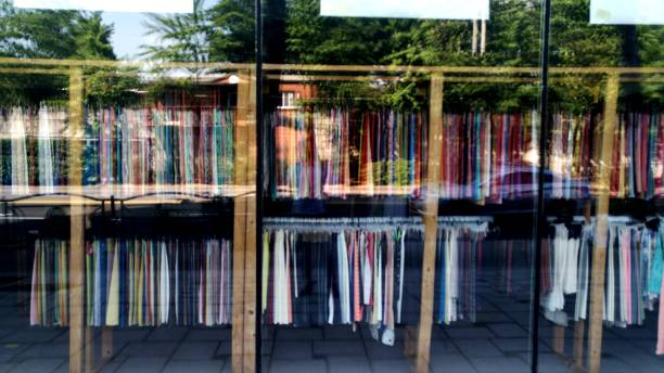 Reflected Landscape In The Glass Of A Clothes Shop