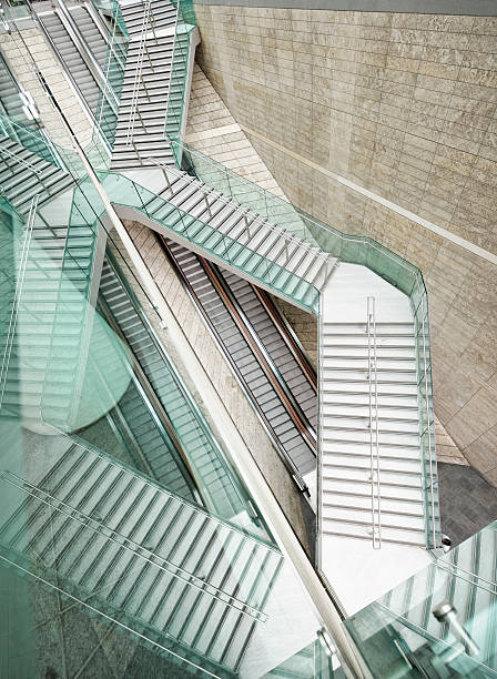 Reflected Modern Architecture - Winding Stairs Over Straight Escalators Wall Art
