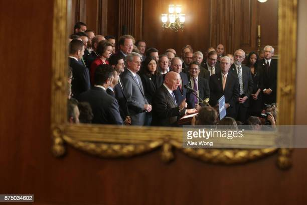 Reflected on a mirror, U.S. House Ways and Means Committee Chairman Rep. Kevin Brady speaks as other House Republicans, including Speaker of the...