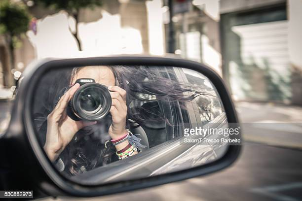 Reflected selfportrait in a rearview mirror