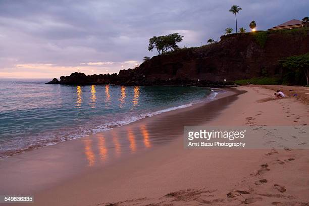 Reflected torches on beach, Maui