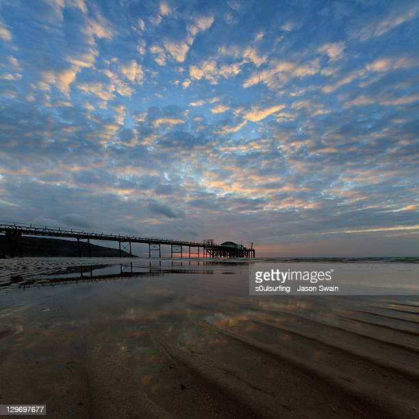 reflecting of clouds into sea - s0ulsurfing stock pictures, royalty-free photos & images
