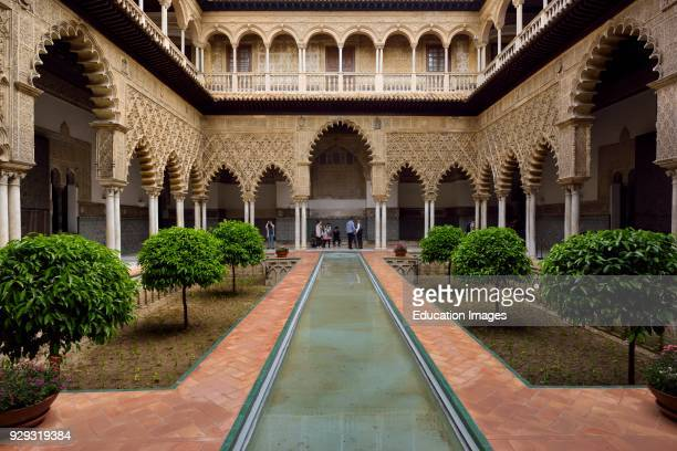 Reflecting pool in the Courtyard of the Maidens at Alcazar palace Seville Andalusia