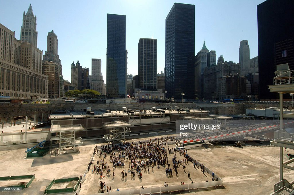 A reflecting pool on the site of the former World Trade Center is surrounded by mourners paying their respects during ceremonies at Ground Zero September 11, 2005 in New York City. This is the fourth anniversary commemoration of the September 11, 2001 attacks.
