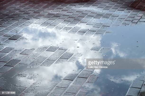 reflection in a puddle of clouds - pontevedra province stock photos and pictures