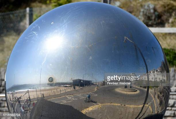Reflection in a silver sphere of Boscombe beach on April 13, 2020 in Bournemouth, United Kingdom. The Coronavirus pandemic has spread to many...