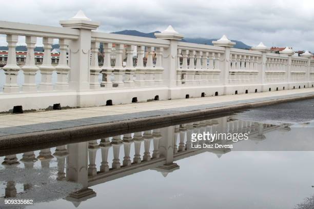 reflection in promeade maritime - pontevedra province stock photos and pictures