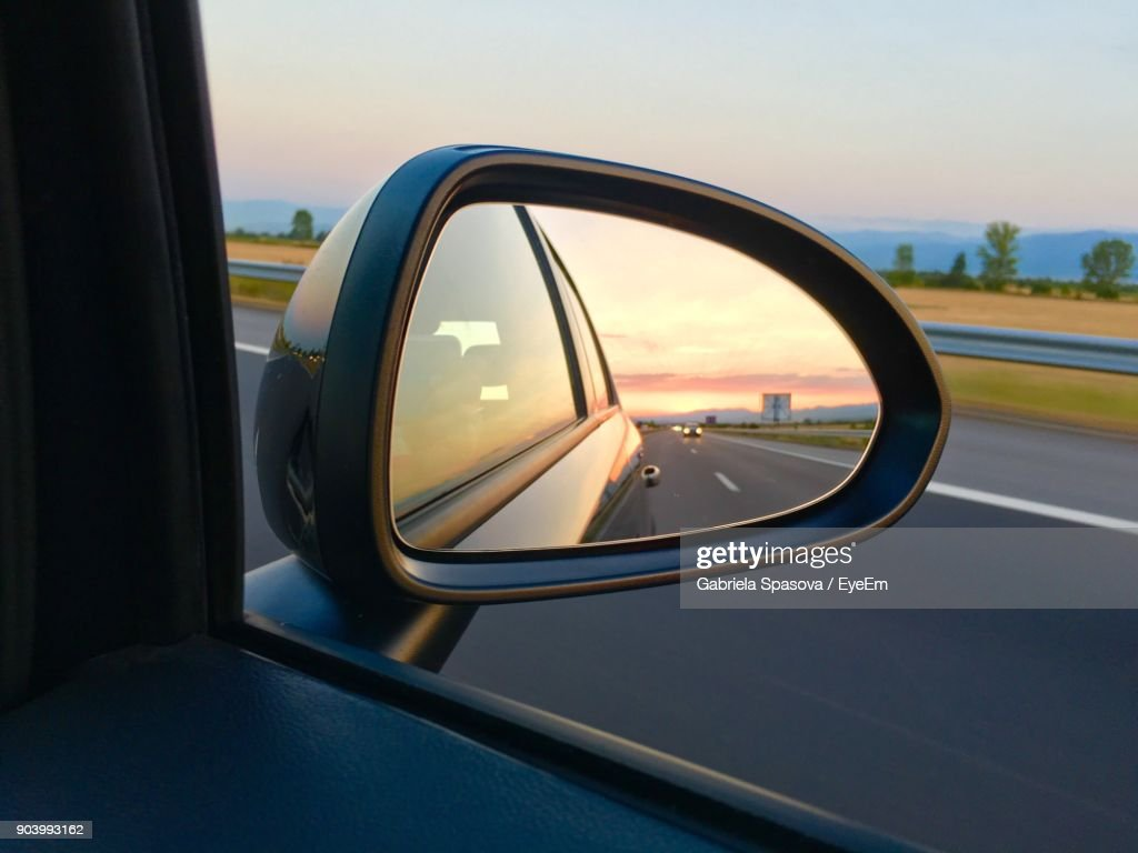 Reflection In Side-View Mirror Of Car : Stock Photo