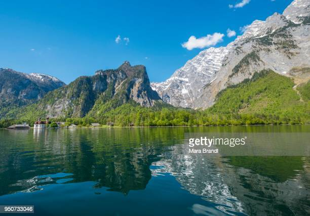 Reflection in the water, Koenigssee lake with Watzmann Massif and pilgrimage church of St. Bartholomew, National Park Berchtesgaden, Berchtesgadener, Upper Bavaria, Bavaria, Germany