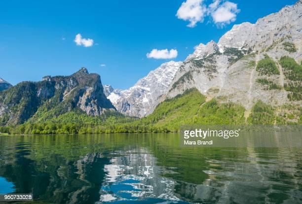 Reflection in the water, Koenigssee lake with Watzmann massif, National Park Berchtesgaden, Berchtesgadener, Upper Bavaria, Bavaria, Germany
