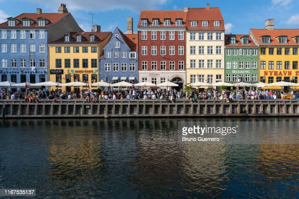 reflection in water of colourful traditional buildings of nyhavn old port - nyhavn stock pictures, royalty-free photos & images