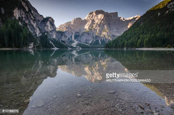 Reflection mirror lake , lake braies south tyrol dolomites north Italy in alps