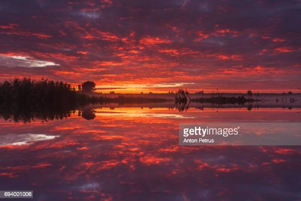Reflection of a beautiful sky at sunrise in the lake