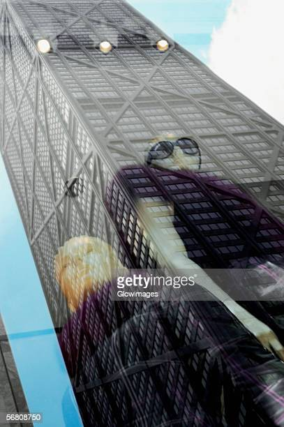 reflection of a building, john hancock building, chicago, illinois, usa - hancock building chicago stock photos and pictures