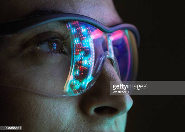 reflection of a circuit board on glasses - professional occupation stock pictures, royalty-free photos & images
