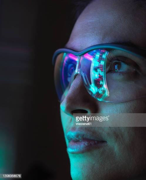 reflection of a circuit board on glasses - artificial intelligence stock pictures, royalty-free photos & images