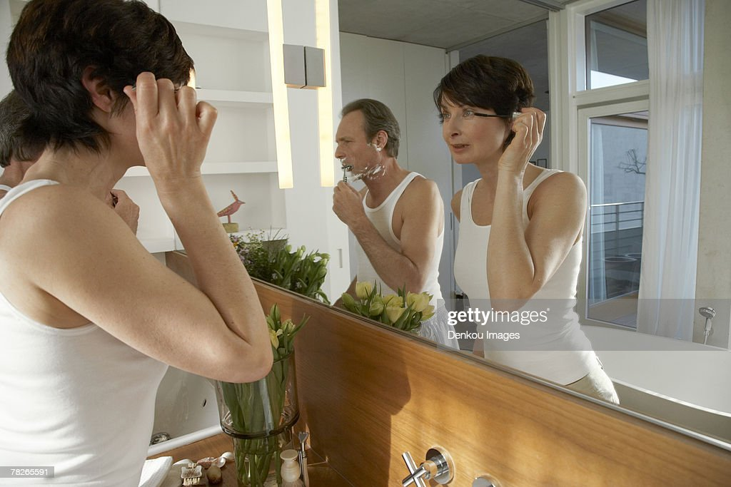Reflection of a couple in the bathroom : Stock Photo
