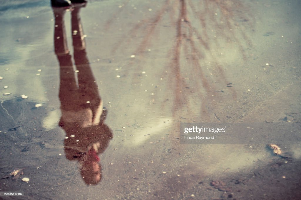 Reflection of a girl in  ice : Stock Photo