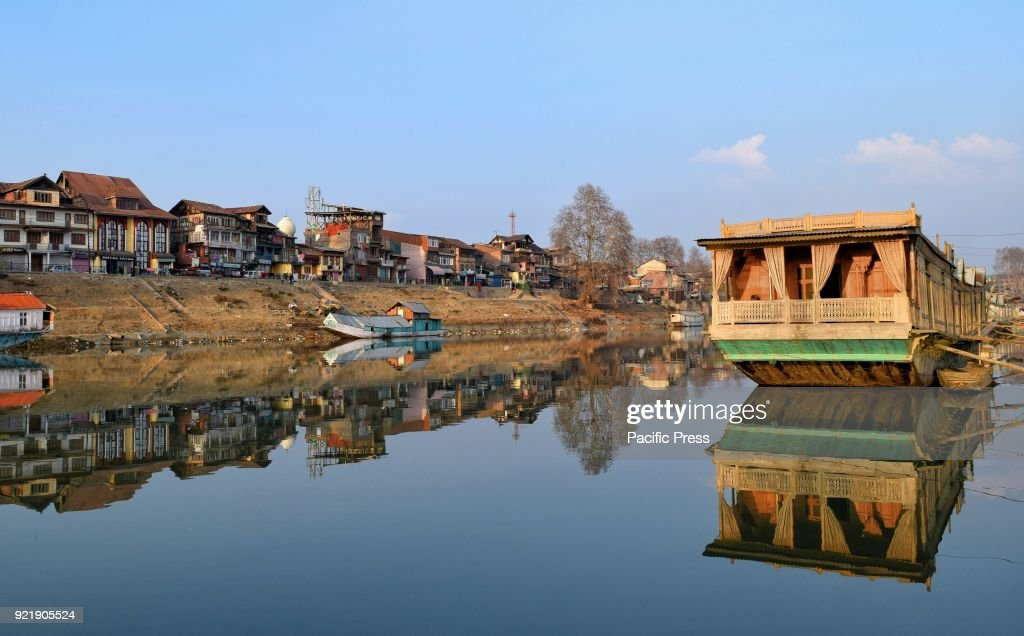 Reflection of a houseboat on the waters of river Jhelum in... : News Photo