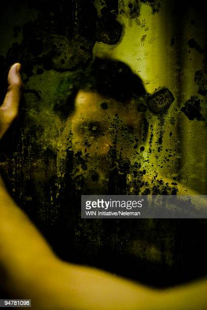 Reflection of a man in the bathroom mirror, Buenos Aires, Argentina