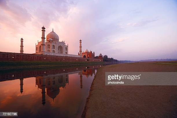 reflection of a mausoleum in water, taj mahal, agra, uttar pradesh, india - agra stock pictures, royalty-free photos & images