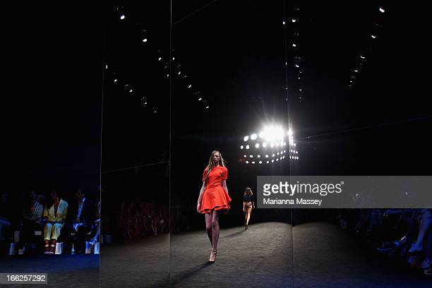 A reflection of a model showcasing designs on the runway at the Suboo show during MercedesBenz Fashion Week Australia Spring/Summer 2013/14 at...