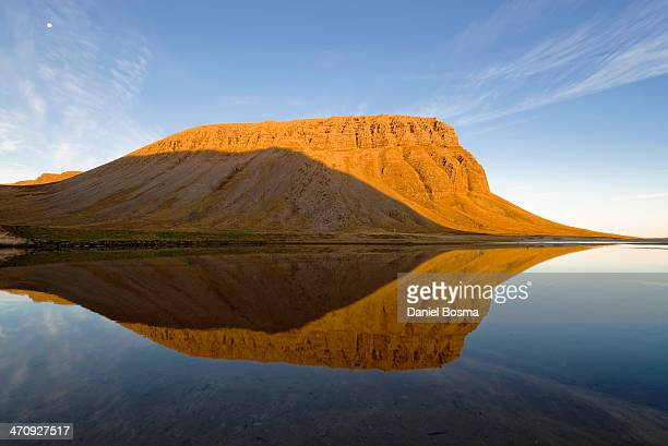 CONTENT] Reflection of a mountain during sunrise in a beautiful bay at the coast of Arnarfjörður one of the Westfjords in Iceland