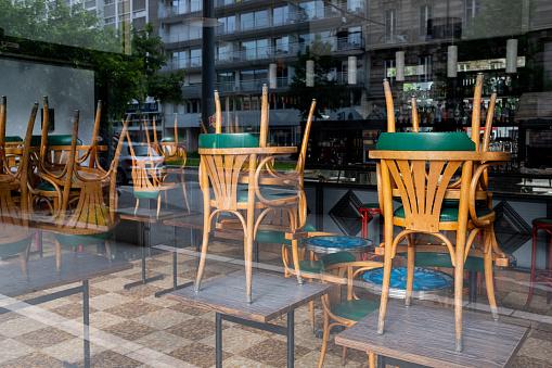 Reflection of a restaurant closed due to coronavirus 1223875917