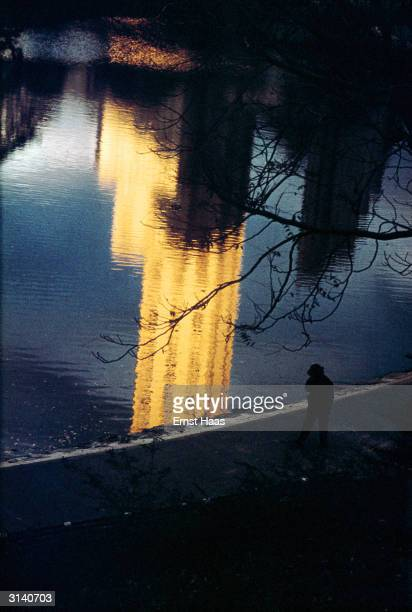 A reflection of a sunlit skyscraper in a lake in New York's Central Park Colour Photography book