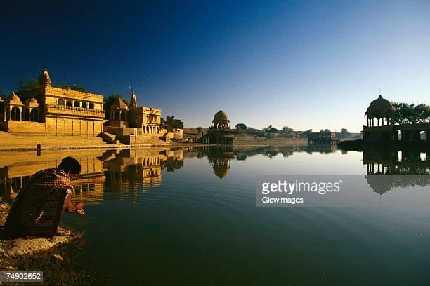 Reflection of a temple in a lake, Gadsisar Lake, Jaisalmer, Rajasthan, India