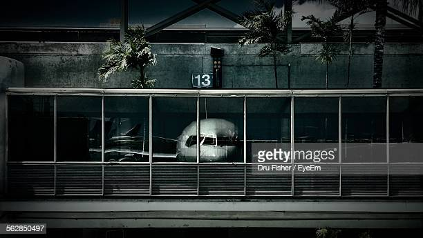 Reflection Of Airplane On Airport Windows