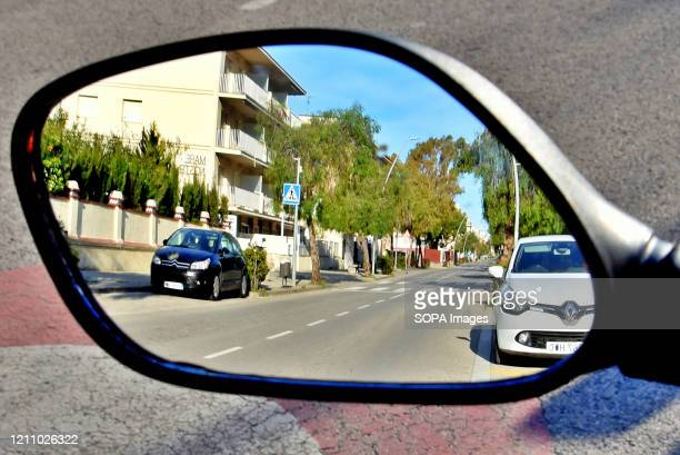 Reflection of Av Paufuriana street completely empty during confinement 43 days since the government of Spain decreed the state of alarm and...