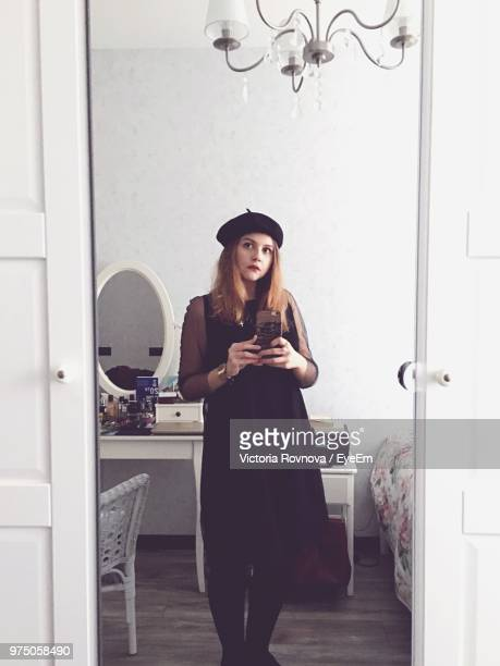 reflection of beautiful young woman in mirror taking selfie at home - mirror selfie stock pictures, royalty-free photos & images