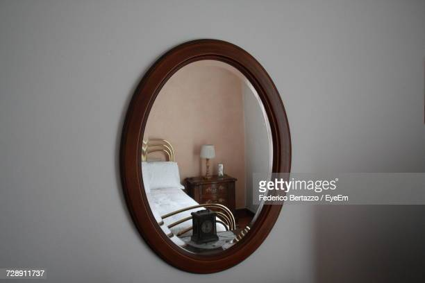 Reflection Of Bedroom In Mirror