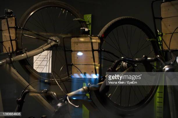 reflection of bicycle on window glass - klein stock pictures, royalty-free photos & images