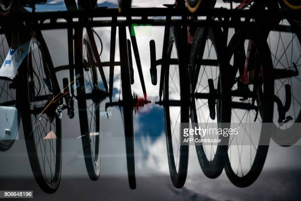 A reflection of bikes on the windscreen of a team vehicle is pictured prior to the start of the 2125 km third stage of the 104th edition of the Tour...